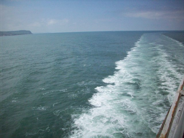 Ferry water trail through the English Channel on a clear day.